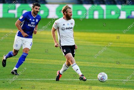 Tim Ream of Fulham passes ahead of Callum Paterson of Cardiff City