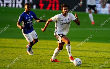 Junior Hoilett of Cardiff City chases Cyrus Christie of Fulham