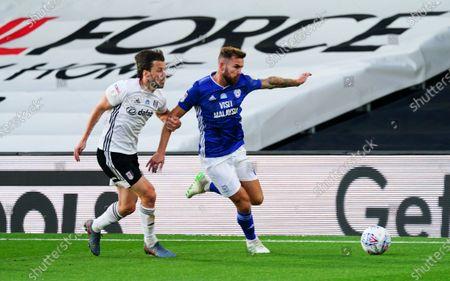 Harry Arter of Fulham battles with Joe Ralls of Cardiff City