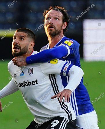 Aleksander Mitrovic of Fulham battles with Sean Morrison of Cardiff City