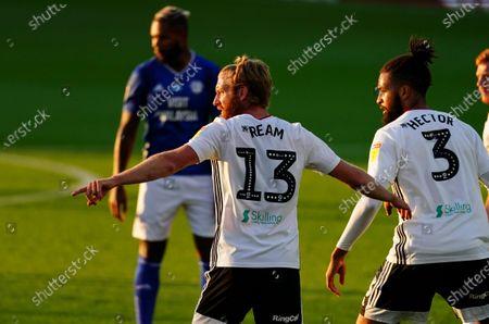 Tim Ream alongside Michael Hector of Fulham