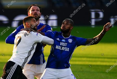 Aleksander Mitrovic of Fulham grapples with Sean Morrison, centre, and Leandro Bacuna of Cardiff City