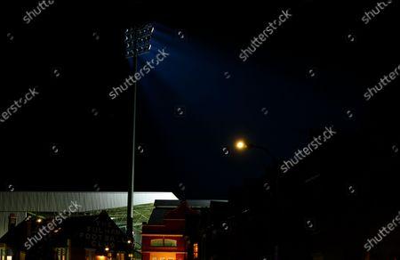 A floodlight casts beams of light after the match