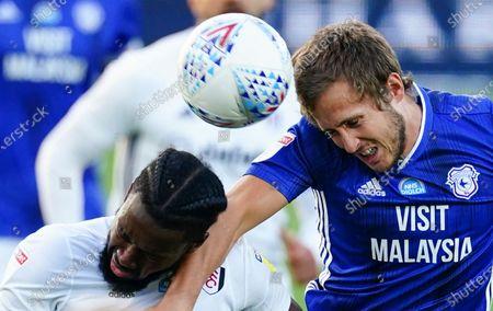 Josh Onomah of Fulham grapples with Will Vaulks of Cardiff City