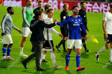 Fulham Manager Scott Parker shakes hands with Sean Morrison of Cardiff City at full time