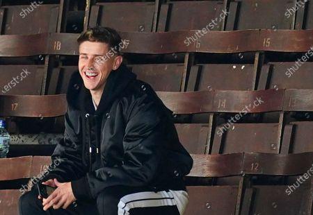 Injured Tom Cairney of Fulham laughs