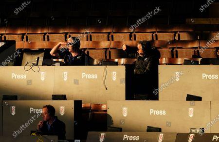 Fulham commentator Jim McGullion looks on, left, alongside co-commentator Jamie Reid