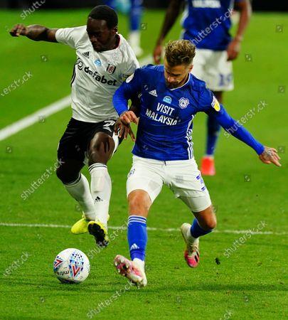 Neeskens Kebano of Fulham battles with Joe Bennett of Cardiff City