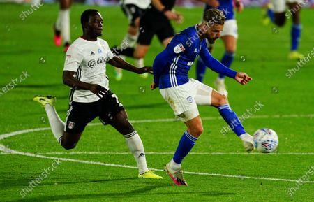 Neeskens Kebano of Fulham chases Joe Bennett of Cardiff City