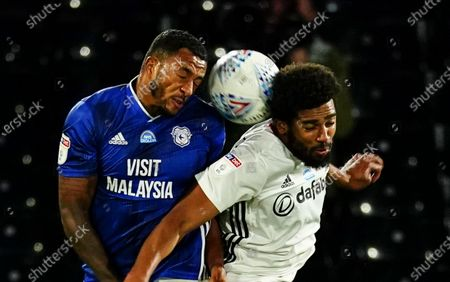 Nathaniel Mendez-Laing of Cardiff City battles with Cyrus Christie of Fulham