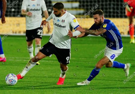 Joe Ralls of Cardiff City grabs the arm of Aleksander Mitrovic of Fulham