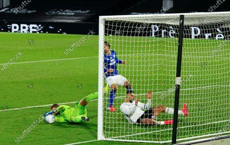 Goalkeeper Alex Smithies of Cardiff City denies a sliding Aleksander Mitrovic of Fulham