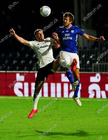 Joe Bryan of Fulham battles with  Will Vaulks of Cardiff City