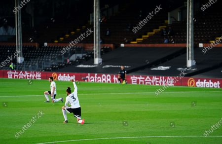 Michael Hector of Fulham takes the knee
