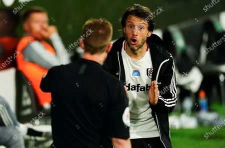 Harry Arter of Fulham questions the linesman