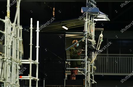 A television cameraman in a temporary structure