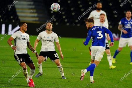 Joe Bennett of Cardiff City heads clear