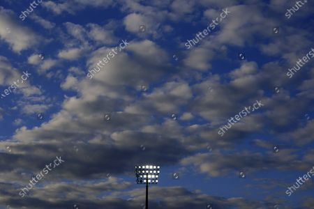 Fluffy clouds above one of the floodlight pylons ahead of kick off