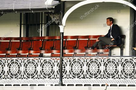 Fulham Manager Scott Parker looks on from the Craven Cottage balcony during the warm up