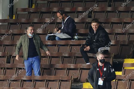 Stock Photo of Tom Cairney of Fulham in the stands with Javier Pereira