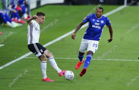 Joe Bryan of Fulham and Nathaniel Mendez-Laing of Cardiff City