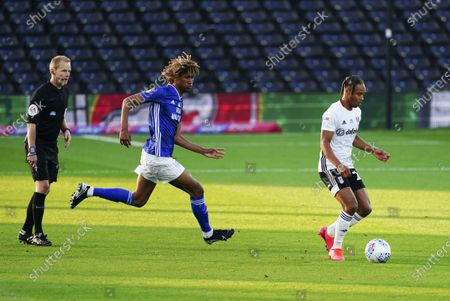 Dion Sanderson of Cardiff City chases Bobby De Cordova Reid of Fulham