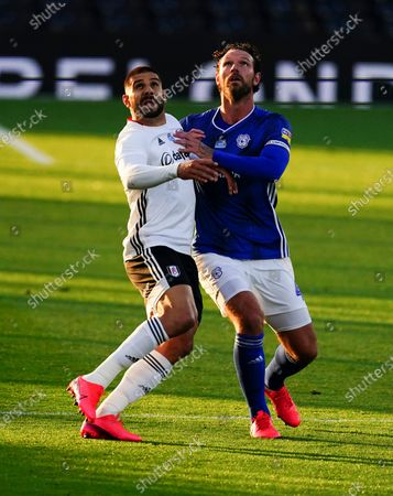 Aleksander Mitrovic of Fulham grapples with Sean Morrison of Cardiff City
