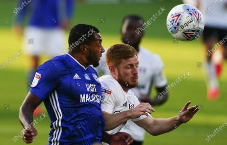 Nathaniel Mendez-Laing of Cardiff City battles with Harrison Reed of Fulham