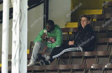 Injured Tom Cairney and Aboubakar Kamara of Fulham