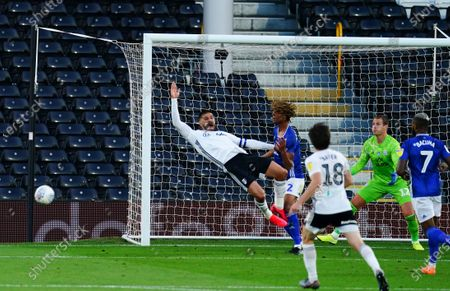 Dion Sanderson of Cardiff City gives away a penalty for this foul on Aleksander Mitrovic of Fulham