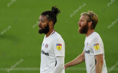 Michael Hector and Tim Ream of Fulham hold firm in the first half