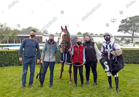 SOCIALIST AGENDA (Adam Wedge) with trainer Laura Morgan (2nd right) after The Betway Standard Open National Hunt Flat Race Market Rasen