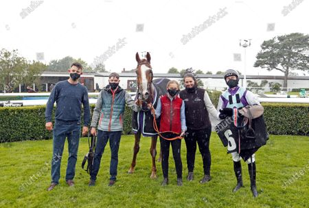 Stock Picture of SOCIALIST AGENDA (Adam Wedge) with trainer Laura Morgan (2nd right) after The Betway Standard Open National Hunt Flat Race Market Rasen
