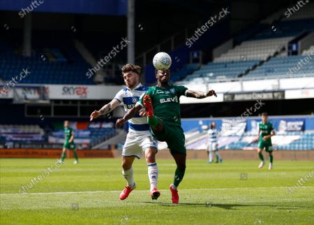 The Kiyan Prince Foundation Stadium, London, England; Ryan Manning of Queens Park Rangers challenges Moses Odubajo of Sheffield Wednesday; English Championship Football, Queen Park Rangers versus Sheffield Wednesday.
