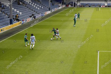 The Kiyan Prince Foundation Stadium, London, England; Luke Amos of Queens Park Rangers challenges Josh Windass of Sheffield Wednesday inside an empty The Kiyan Prince Foundation Stadium; English Championship Football, Queen Park Rangers versus Sheffield Wednesday.