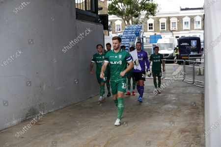 The Kiyan Prince Foundation Stadium, London, England; Tom Lees of Sheffield Wednesday leads his team mates onto the pitch from the away tunnel before kick off; English Championship Football, Queen Park Rangers versus Sheffield Wednesday.