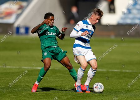 The Kiyan Prince Foundation Stadium, London, England; Jacob Murphy of Sheffield Wednesday challenges Jack Clarke of Queens Park Rangers; English Championship Football, Queen Park Rangers versus Sheffield Wednesday.