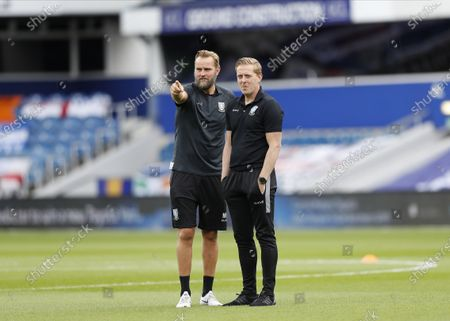 The Kiyan Prince Foundation Stadium, London, England; Sheffield Wednesday Manager Garry Monk chatting with Sheffield Wednesday Goalkeeper Coach Nicky Weaver on the pitch as the Sheffield Wednesday team arrive at The Kiyan Prince Foundation Stadium; English Championship Football, Queen Park Rangers versus Sheffield Wednesday.