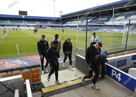 The Kiyan Prince Foundation Stadium, London, England; Sheffield Wednesday players walking back into the away dressing room after inspecting the pitch at The Kiyan Prince Foundation Stadium; English Championship Football, Queen Park Rangers versus Sheffield Wednesday.