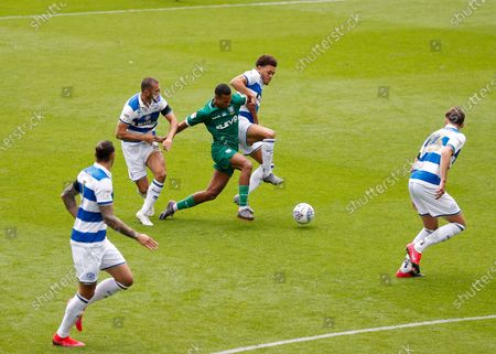The Kiyan Prince Foundation Stadium, London, England; Alessio da Cruz of Sheffield Wednesday being challenged by Dominic Ball and Luke Amos of Queens Park Rangers; English Championship Football, Queen Park Rangers versus Sheffield Wednesday.