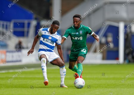 The Kiyan Prince Foundation Stadium, London, England; Moses Odubajo of Sheffield Wednesday challenges Olamide Shodipo of Queens Park Rangers; English Championship Football, Queen Park Rangers versus Sheffield Wednesday.