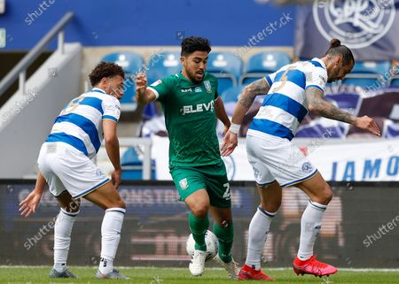 The Kiyan Prince Foundation Stadium, London, England; Massimo Luongo of Sheffield Wednesday being challenged by Geoff Cameron and Luke Amos of Queens Park Rangers; English Championship Football, Queen Park Rangers versus Sheffield Wednesday.