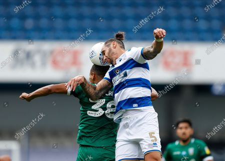 The Kiyan Prince Foundation Stadium, London, England; Geoff Cameron of Queens Park Rangers challenges Alessio da Cruz of Sheffield Wednesday; English Championship Football, Queen Park Rangers versus Sheffield Wednesday.