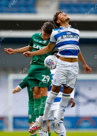 The Kiyan Prince Foundation Stadium, London, England; Alex Hunt of Sheffield Wednesday challenges Luke Amos of Queens Park Rangers; English Championship Football, Queen Park Rangers versus Sheffield Wednesday.