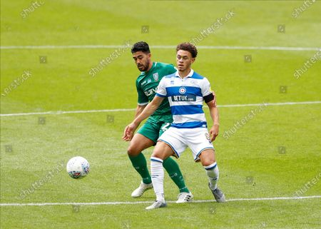 The Kiyan Prince Foundation Stadium, London, England; Massimo Luongo of Sheffield Wednesday challenges Luke Amos of Queens Park Rangers; English Championship Football, Queen Park Rangers versus Sheffield Wednesday.