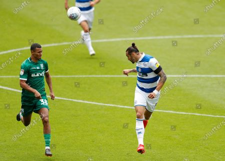 The Kiyan Prince Foundation Stadium, London, England; Geoff Cameron of Queens Park Rangers heads the ball over Alessio da Cruz of Sheffield Wednesday; English Championship Football, Queen Park Rangers versus Sheffield Wednesday.
