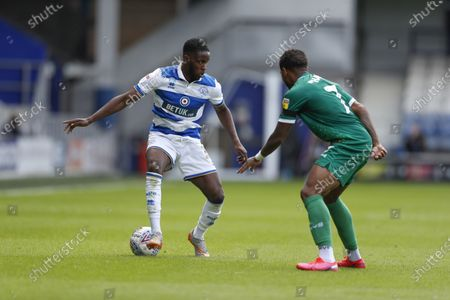 The Kiyan Prince Foundation Stadium, London, England; Olamide Shodipo of Queens Park Rangers being marked by Marc Pugh of Queens Park Rangers; English Championship Football, Queen Park Rangers versus Sheffield Wednesday.
