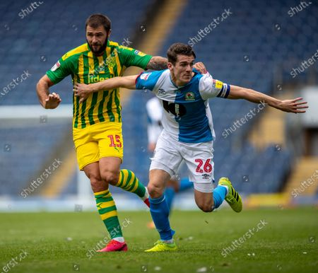 Ewood Park, Blackburn, Lancashire, England; Charlie Austin of West Bromwich Albion has hold of the shirt of Darragh Lenihan of Blackburn Rovers; English Football League Championship Football, Blackburn Rovers versus West Bromwich Albion.
