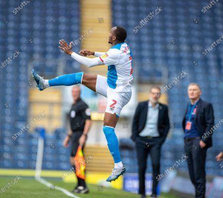 Ewood Park, Blackburn, Lancashire, England; Ryan Nyambe of Blackburn Rovers rises high with West Brom manager Slaven Bili? and Blackburn Rovers manager Tony Mowbray watching on in the background; English Football League Championship Football, Blackburn Rovers versus West Bromwich Albion.