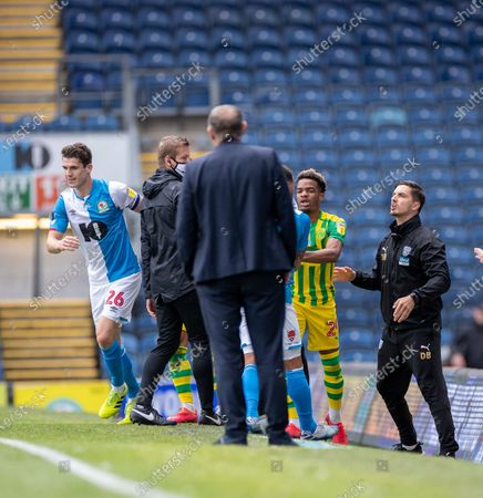 Ewood Park, Blackburn, Lancashire, England; Darragh Lenihan of Blackburn Rovers is yellow carded on the sideline after a foul on Semi Ajayi of West Bromwich Albion; English Football League Championship Football, Blackburn Rovers versus West Bromwich Albion.